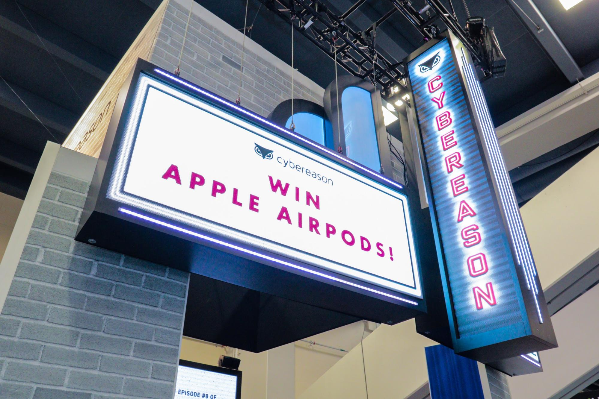 """Cybereason """"Win Apple AirPods"""" sign"""